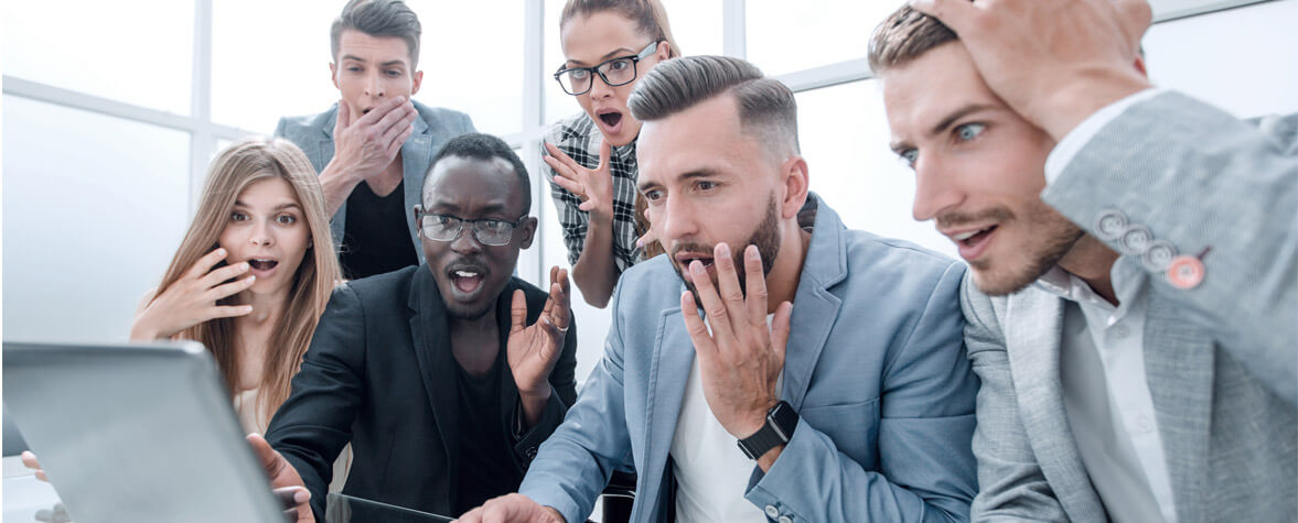 Shocked employees looking at computer screen